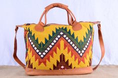 Handmade in Guatemala; this fair trade leather and embroidery purse will become a classic in your purse collection.  Check out this item in my Etsy shop https://www.etsy.com/listing/212869329/leather-and-mustard-embroidery