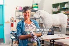 Stock-Foto : Caucasian sculptor working in studio