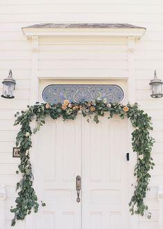 Church doorway garland by Sarah Winward. Photo by Alixanne Loosle.