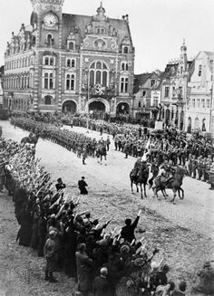 """One of Hitler's early coups that went unanswered by the """"Great Powers."""" German troops march into the Rhineland on 1 March 1936 reoccupying a region that was put under Allied control after WW1. German troops executed a walk and, presto, the Rhineland was German again! Talking about a game of chicken."""