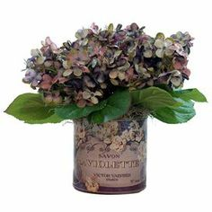 Silk lilac arrangement in a glass planter with French label.   Product: Faux floral arrangementConstruction Material: Glass, plastic, silicone and silkColor: Purple and greenFeatures: For indoor use onlyDimensions: 10 H x 10 Diameter
