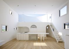 Japanese architects Future Studio conceived the rooftop terrace of this Hiroshima house as a stage, with its audience in the living room and kitchen.