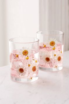 Shop Pressed Daisy Glass - Set Of 2 at Urban Outfitters today. We carry all the latest styles, colors and brands for you to choose from right here.