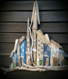 driftwood town/houses with little sailboat with seaglass. Beach Art. made by EVA s.