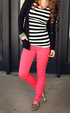 Hot pink jeans, cheetah print flats, black and white striped shirt, a black sweater, and to close it off, a beaded bracelet with a heavy necklace. Good way to tone down bright colors