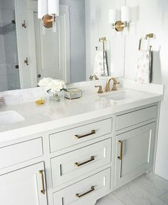 Light grey cabinet paint color: Gray Cashmere by Benjamin Moore. This light grey paint color works great with white marble or white quartz countertop and brass hardware Benjamin Moore Cashmere Gray, Light Gray Cabinets, Bathroom Renos, Bathroom Ideas, Master Bathroom, Gold Bathroom, Basement Bathroom, Master Closet, Bath Ideas