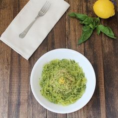 Homemade pesto over spaghetti squash noodles. Low-carb and paleo.