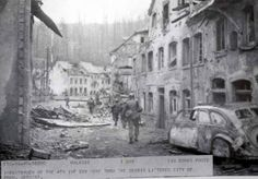 Infantrymen of the 4th Infantry Division move through the debris littered city of Prum, Germany.