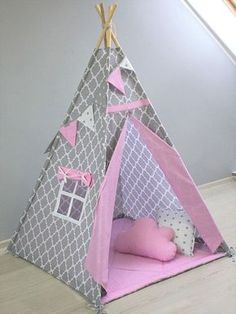 Playhouse ideas range from uncomplicated to very fancy and which playhouse blueprints you decide on will depend on multiple factors. Several years ago my wife sent away for a set of playhouse plans with the notion that I would build i Wooden Playhouse Kits, Build A Playhouse, Kids Tents, Teepee Kids, Teepees, Tent House For Kids, Indian Teepee, Childrens Teepee, Teepee Play Tent