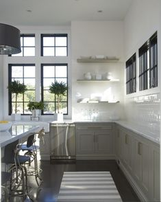 grey cabinet, white subway tile open shelf