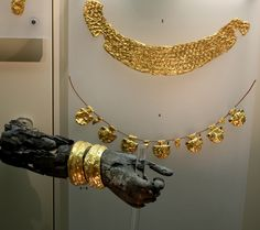 Gold and fire-blackened ivory fragments of a burnt Archaic chryselephantine statue. Archaeological Museum of Delphi.