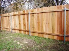 wooden slat fence with metal posts for support | Wood Privacy Fence on Steel Posts - Western Red Cedar
