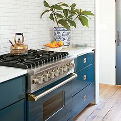 A Viking range in the Viking Blue custom color. Jen lacquered the surrounding cabinet doors to match the stove....