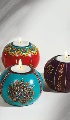 Made from Mango wood these tealight holders are handpainted in rich vibrant colours to create a unique and distinctive addition to any room.