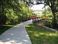 photo of trail and bridge in park