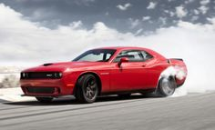 BADASS! Dodge Challenger SRT Hellcat Runs The Quarter Mile In 11.2 Secs. Click to be blown away...