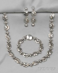 Sterling Silver Suite, Georg Jensen, comprising a necklace, bracelet, and earpendants, all with foliate links, lg. 14 5/8, 7, 2 in., no. 96A, 96, 40, signed Georg Jensen, Denmark.