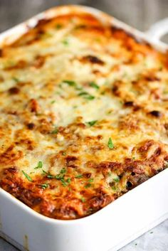 Authentic Eggplant Parmesan in a baking white dish.You can find Eggplant parmesan and more on our website.Authentic Eggplant Parmesan in a baking white dish. Vegetable Recipes, Vegetarian Recipes, Cooking Recipes, Healthy Recipes, Italian Dishes, Italian Recipes, Eggplant Dishes, Comfort Food, Vegetable Dishes