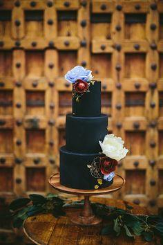 black wedding cakes - photo by KMitiska Photography http://ruffledblog.com/summer-harvest-wedding-inspiration