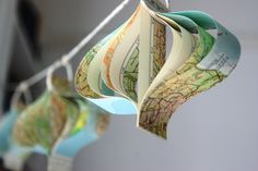 "map garland by Bookity she calls them ""paper onions"" very similar to a heart ornament tutorial I've used"