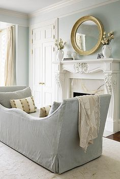 I absolutely love this color combination - crisp white woodwork and this softest blue green on the walls.
