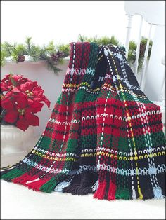 Holiday Tartan Afghan -- I made one of these in purple, turqouise, yellow, white & lime for our guest room.