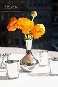 Planned, Designed & Produced by www.swankproductions.com orange capital #swankproductions #corporateparty #620loftandgarden #chic #party #eventplanner #bestofthebest #nyc #reception #colorful #decor #lounge #fun #flowers #rooftop #manhattan #orange #ranunculus #ideas #inspiration #beautiful #candles #silver #vase