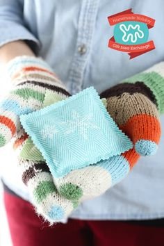 These rice and lavender hand warmers are a cozy winter treat. They may seem to lack a certain high powered, high priced, in-demand shiny Christmas present quality, but believe me, they are magical. Because nothing is more comforting when you just can't get warm. Make them for your office mates, your aunt, your dog walker — everyone will love them. Guaranteed.