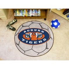 FANMATS 5145 : For all those soccer fans out there: soccer ball-shaped area rugs by FANMATS. Made in U.S.A. 100% nylon carpet and non-skid Duragon? latex backing. Machine washable. Officially licensed. Chromojet printed in true team colors.