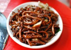 Hokkian Noodles - Thick yellow noodles cooked over high fire with thick black soy sauce. One of the best noodle dishes in KL.