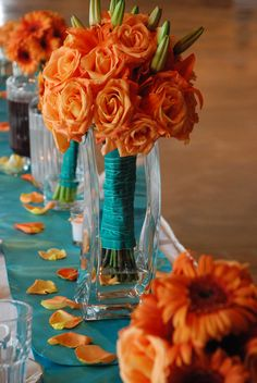 table decoration wedding reception orange and blue photography