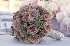 Gorgeous bouquet in shades of dusty lavender and green.