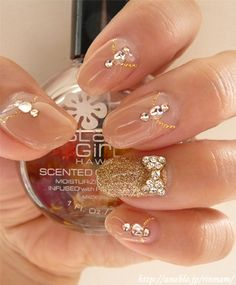 I like the nude nails with the gold glitter accent nail. The bling is just the right amount too. Cute!