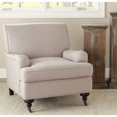 @Overstock.com - Safavieh Nottingham Sand Beige Club Chair - Transport your decor back to the olden days with this timeless club chair. Covered with a linen fabric in beige, this chair features a wide back and cushioned arms for comfort. A mahogany wood finish lends this chair a contemporary style and durability.  http://www.overstock.com/Home-Garden/Safavieh-Nottingham-Sand-Beige-Club-Chair/6002297/product.html?CID=214117 $349.99