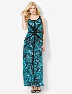 All eyes are on you in our new, unique maxi dress. We designed the flourishing print with bold solid stripes that visually slim your shape. Scoop neckline. Sleeveless. Catherines dresses are expertly designed for the plus size woman. catherines.com