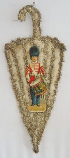 "Victorian Christmas ornament, cotton batting parasol with scrap paper toy soldier playing drum, tinsel garland trim, 11"" h. 