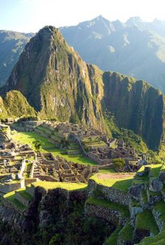 Machu Picchu, the most famous icon of the Inca Empire.  It is situated on a mountain ridge above the Sacred Valley which is 80 kilometres (50 mi) northwest of Cusco, Peru.