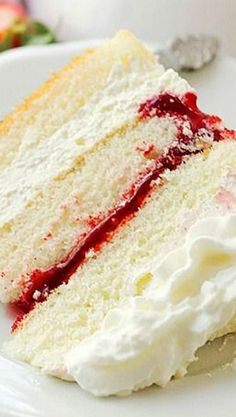 Strawberry Shortcake Cake - Layers of moist, buttery cake filled with strawberry pie filling and whipped cream frosting.