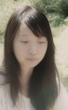 A moment lost in thought - portrait of a young Japanese girl in the summer while she was lost in thought