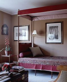 In the guest room of a restored late-Georgian townhouse on London's Montagu Square, camel-hair-covered walls surround a French Directoire campaign bed with a canopy of red and white ticking. Whealon used an antique Persian textile as a bedspread. Photo courtesy of Elle Décor.