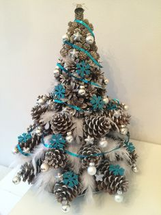 Christmasstree from cones and feathers made by Loli #madebyloli #christmass #tree #homemade #christmassideas #decoration #homedecor #turquoise #white #silver