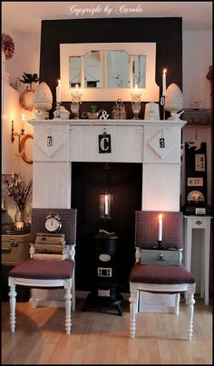 Black chimney wall from: Boxwood Cottage: About painting black & white, repurposing & crafting