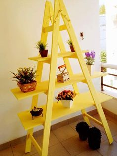 Many different ways to use an old ladder as decor and storage function in your home; very clever ideas