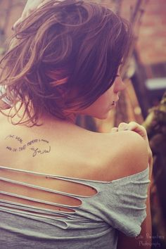 I don't know why, but I really like this photo!  Probably her beautiful romantic hair and the line of her shoulder blade...tattoo is pretty cool too![Perks of Being A Wallflower quote tattoo]