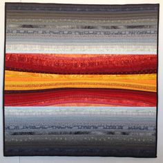 "Quilted wall hanging. Red and grey quilt. Square  art for the wall. River of dawn pieced and quilted by AnnBrauer 37x37"" I love the controlled contrast of the red and yellow river against the more geometric banks that envelop it."