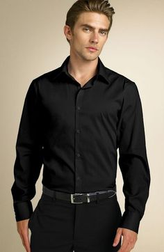 Black dress shirt, black pants and black shoes, different coloured corsages for the groomsmen.