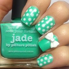 Cute polka dot nails with a tiny little bow!