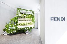 A Piaggio Ape covered in green and converted into a flower shop. The Ape is an adorable 3-wheeled vehicle produced by Italian carmaker Piaggio. It was originally designed by the inventor of the Vespa and was intended to aid the struggling class of post-war Italy. Well now instead of transporting goods it's selling flowers at the Ginza flagship store of Italian luxury brand Fendi. The pop-up flower shop is a collaboration between Fendi and floral artist Makoto Azuma…