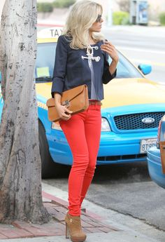 mollie king - red jean, nude toned clutch and booties,  navy jacket w knot detail.
