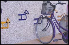 Compact Cycle Racks for Secure and Organised Bicycle Parking in Societies/ Institutes & Industries.  A very Low cost solution
